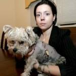 Karine Malec of Naperville holds her 2-year-old dog, Jasper.